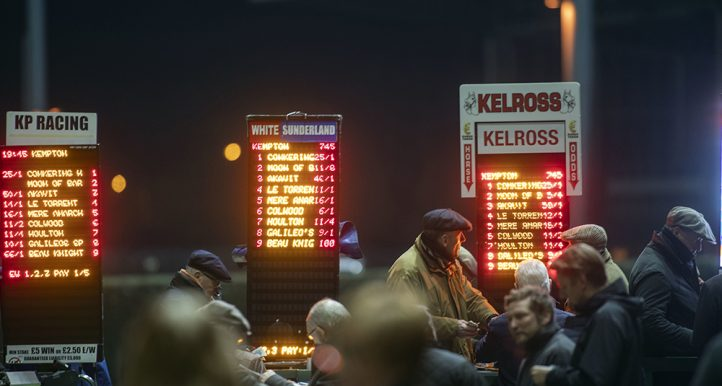 Spectators bet at Kempton Park Racecourse, Esher.