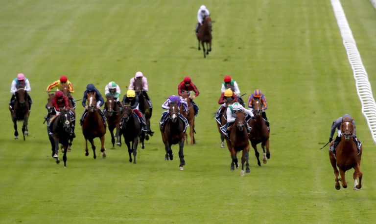English King (yellow cap) finished fifth at Epsom