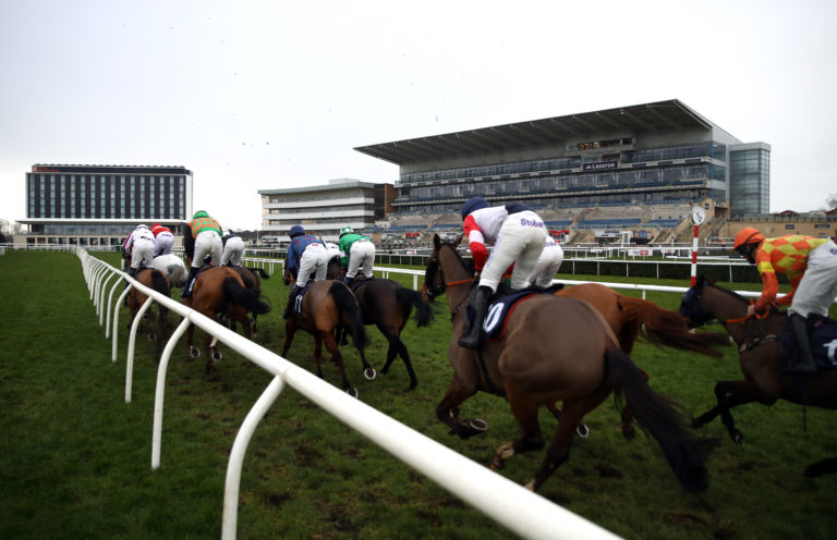 The field pass the empty grandstand at Doncaster earlier this week