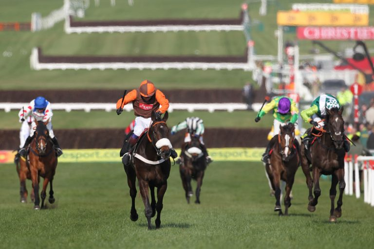 Long Run (middle) left the mighty Denman ad Kauto Star in his wake as he won the 2011 Gold Cup