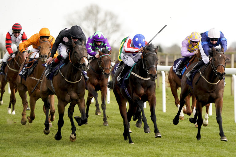 Blue Collar Lad and Sean Levey (centre) on the way to victory
