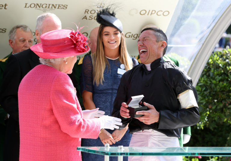 Frankie Dettori receives a memento for winning the 2018 Gold Cup from the Queen