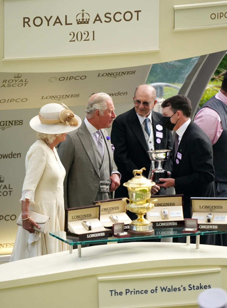 Aidan O' Brien collects his trophy from the Prince of Wales and the Duchess of Cornwall after Ryan Moore won the Prince of Wales's Stakes on Love