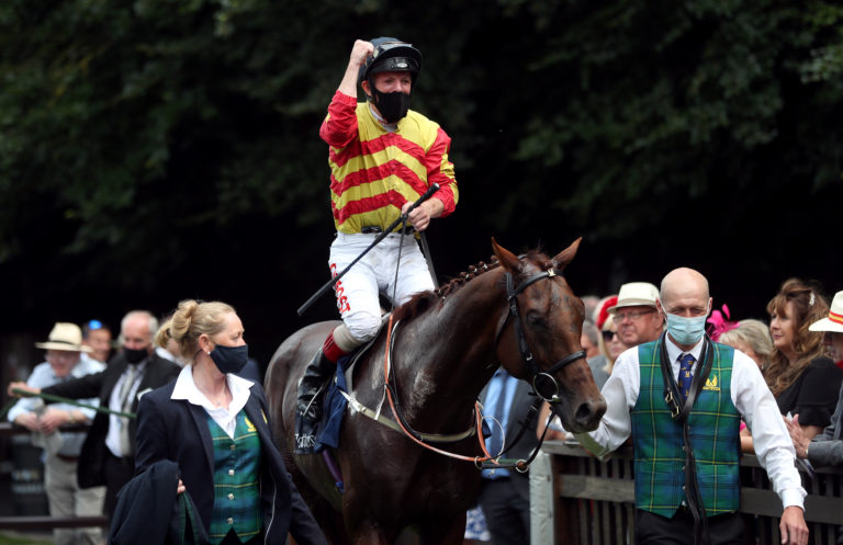 Franny Norton celebrates after winning the Princess Of Wales's Stakes on Sir Ron Priestley