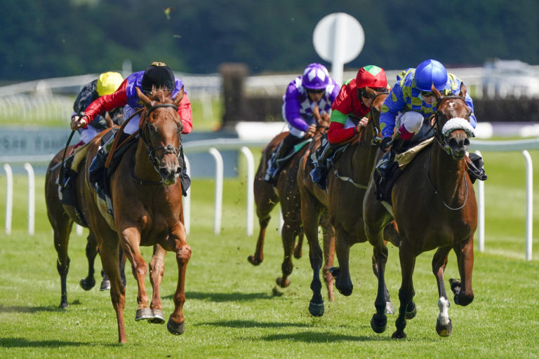 Intelligentsia (left, red sleeves) on her way to victory at Newbury