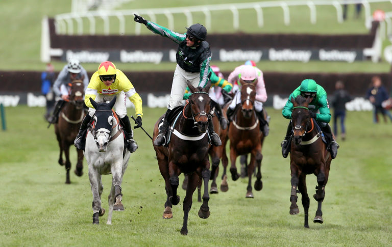 Altior surges up the hill to win a second Queen Mother
